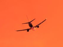 Silhouette of aircraft flying in the sky Royalty Free Stock Photo