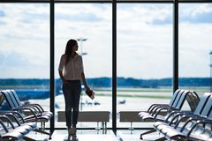 Silhouette of airline passenger in an airport. Silhouette of passenger in an airport lounge waiting for flight aircraft Stock Photo
