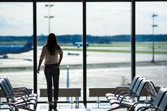 Silhouette of airline passenger in an airport. Silhouette of passenger in an airport lounge waiting for flight aircraft Stock Photos