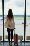 Silhouette of airline passenger in an airport lounge waiting for flight aircraft. Silhouette of passenger in an airport lounge waiting for flight aircraft Royalty Free Stock Photography
