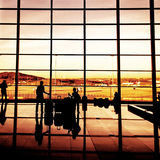 Silhouette of airline passengers in an airport Royalty Free Stock Photo