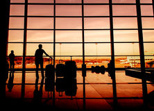 Silhouette of airline passengers in an airport Stock Photo