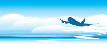 Silhouette of an airplane in the clouds Royalty Free Stock Photo