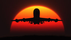 The silhouette of an airplane Stock Image