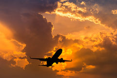 Silhouette airplane flying take off on sunset Royalty Free Stock Photos