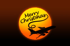 Silhouette of airplane and greeting Christmas text. Sunset background with silhouette of airplane and greeting Christmas text Stock Photos