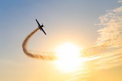 Silhouette of an airplane performing flight Stock Image