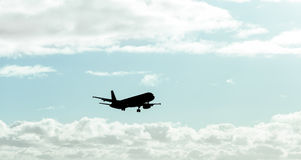 Silhouette, Airplane in the sky Stock Photos
