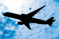Silhouette of an airplane in a sunny sky. Silhouette of an airplane in a sunny Royalty Free Stock Photography