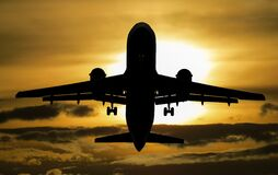 Silhouette of Airplane during Sunset Stock Image