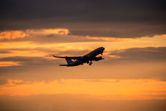 Silhouette of airplane at sunset. Stock Photography