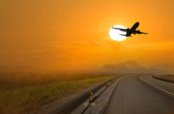 Silhouette of an airplane at sunset. Ailplane sunset aeroplane, silhouette transportation Royalty Free Stock Image