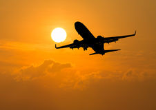 Silhouette of an airplane at sunset. Ailplane sunset  takeoff travel vacation Stock Photo
