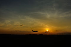 Silhouette airplane with sunset Stock Photos