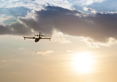 Silhouette of an airplane at sunset. Stock Photography