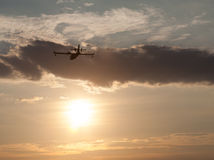 Silhouette of an airplane at sunset. Stock Photo