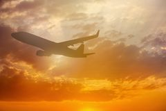 Silhouette of Airplane take off on the Colorful dramatic sky wit Royalty Free Stock Image