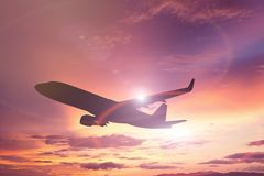 Silhouette of Airplane take off on the Colorful dramatic sky wit Royalty Free Stock Photography