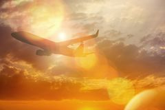 Silhouette of Airplane take off on the Colorful dramatic sky wit Stock Photo