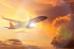 Silhouette of Airplane take off on the Colorful dramatic sky wit Royalty Free Stock Photos