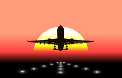 Silhouette of an airplane taking off in background the sun Royalty Free Stock Photos