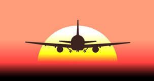 Silhouette of an airplane taking off in background the sun Royalty Free Stock Photo