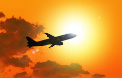 Silhouette of an  airplane taking off Stock Images