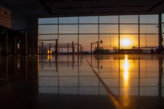 Silhouette of a airport at sunset Stock Images