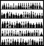 Silhouette alcohol bottles Stock Image