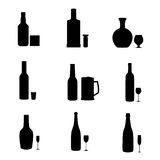 Silhouette alcohol bottles with glasses. Stock Photos