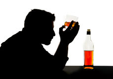 Silhouette of alcoholic drunk man with whiskey glass in alcohol addiction silhouette Stock Photography