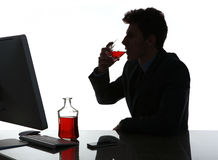 Silhouette of alcoholic drunk young man drinking rum Stock Images