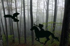 Silhouette of an amazon warrior woman riding a horse with bow an Royalty Free Stock Photos
