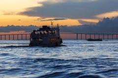 Silhouette of Amazon wooden boat on Rio Negro in Manaus, Brazil Stock Photo