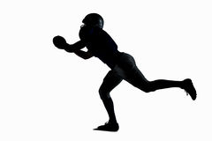 Silhouette American football player catching ball