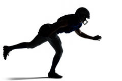 Silhouette American football player jumping Stock Photography