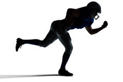 Silhouette American football player running. Against white background Stock Image