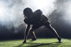 silhouette of american football player in star position against