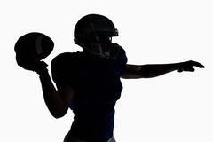 Silhouette American football player throwing ball