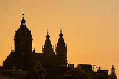 Silhouette of the Amsterdam Nicolaas basilica in the city centre Stock Photography