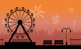 Silhouette amusement park with firework scenery Stock Photography