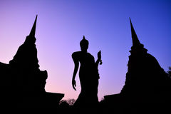Silhouette of ancient Buddha image and old pagoda in Historic To Stock Photos