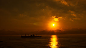 Silhouette of the ancient ship at sunset Stock Photography