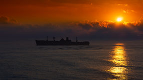 Silhouette of the ancient ship at sunset Stock Photo