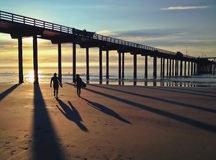 Silhouette And Shadows Of Surfers Along The Pacific Ocean, USA Stock Photo