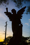 Silhouette of an angel in a cemetery tombstone. Royalty Free Stock Photo