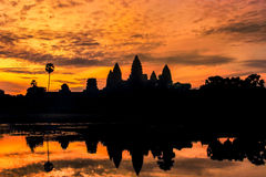 Silhouette angkor wat reflection on the water Royalty Free Stock Image
