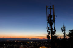 Silhouette antenna with bright colors sunset or sunrise sky. Royalty Free Stock Photography