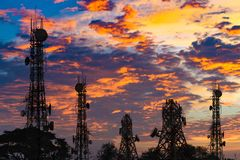 Silhouette of the Antenna of cellular cell phone and communicati Stock Photos