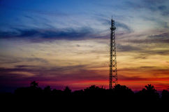 Silhouette  Antenna transmission in sunset time Stock Photography